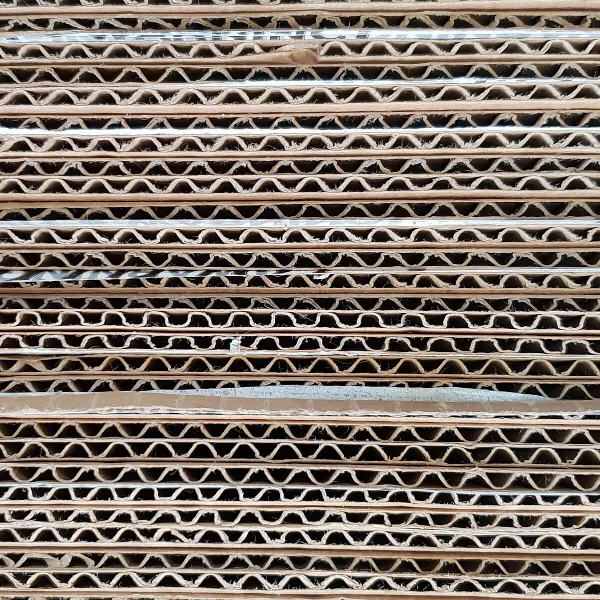 stacked layers of corrugated cardboard