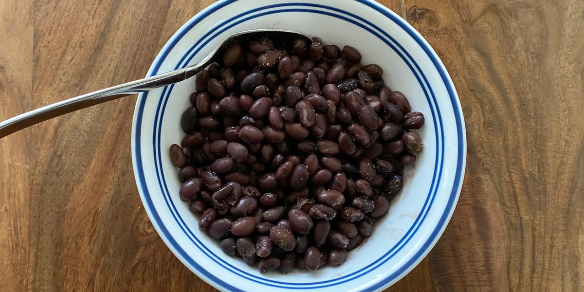 bowl of black beans with spoon