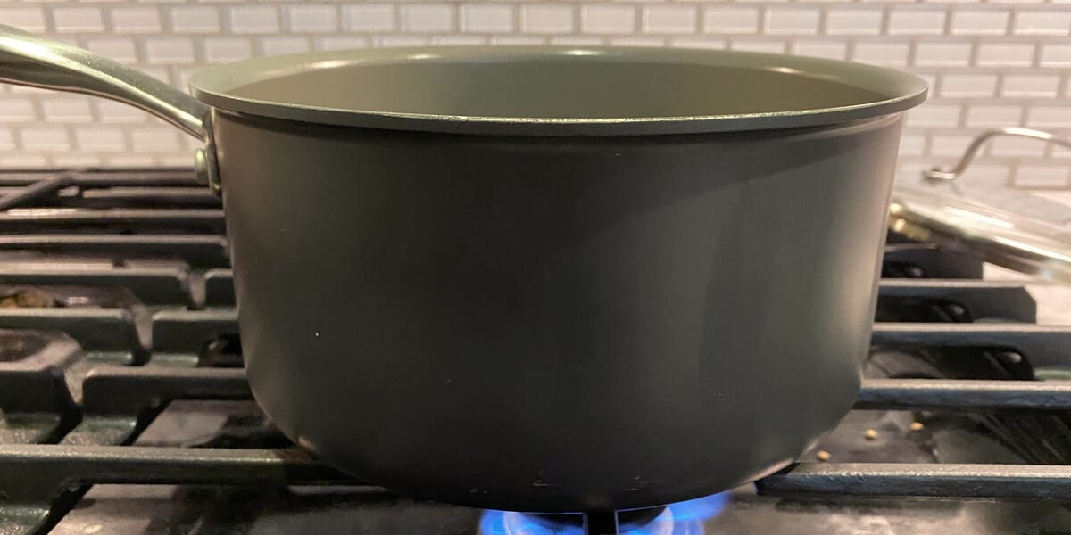 pot of black beans cooking on stove