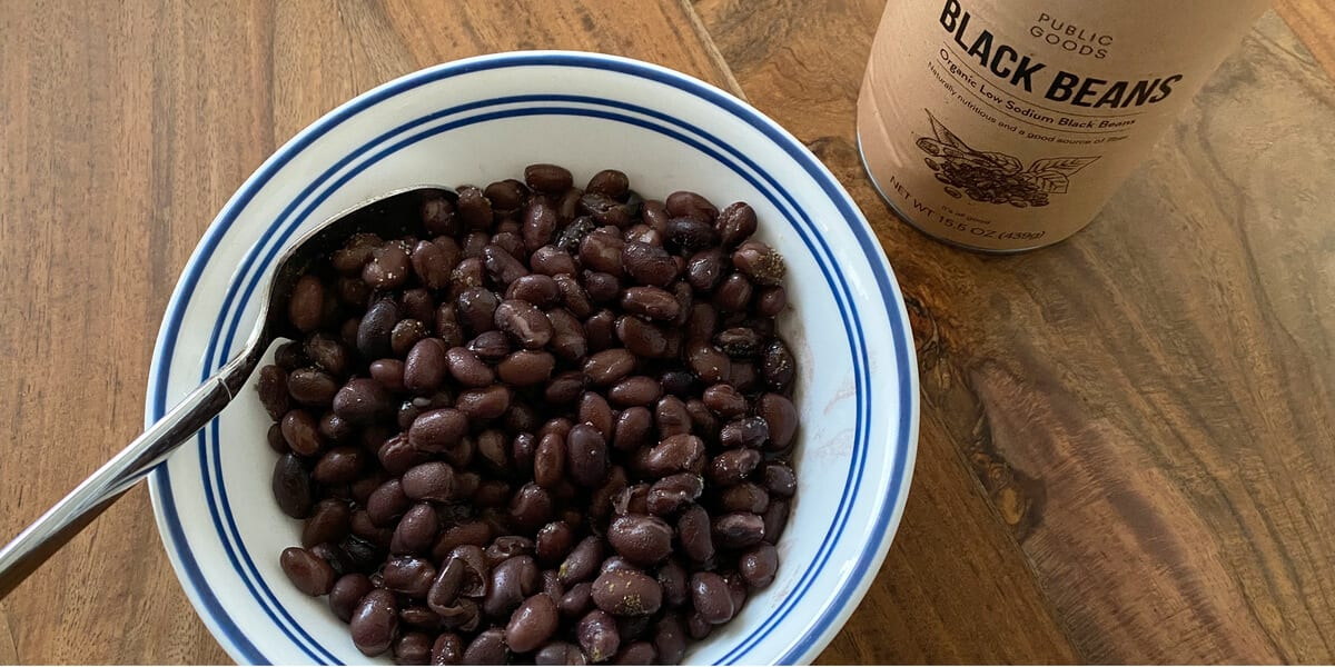 bowl of black beans next to can of black beans