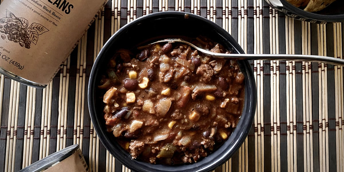 pot of beef and black bean chili next to a can of public goods black beans