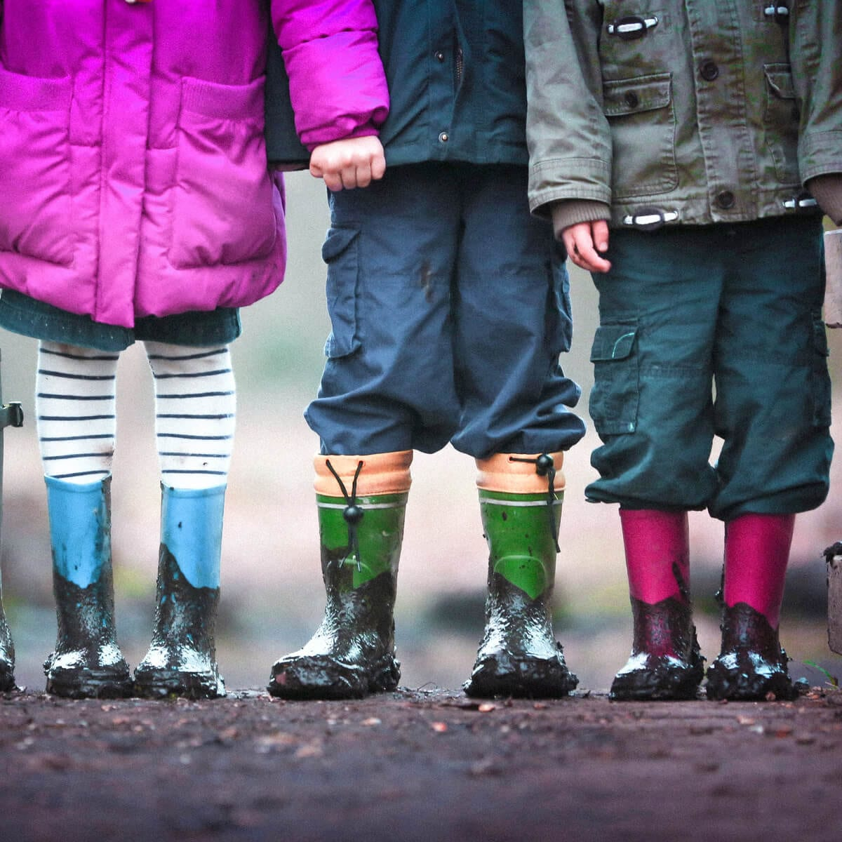 4 children wearing rainboots