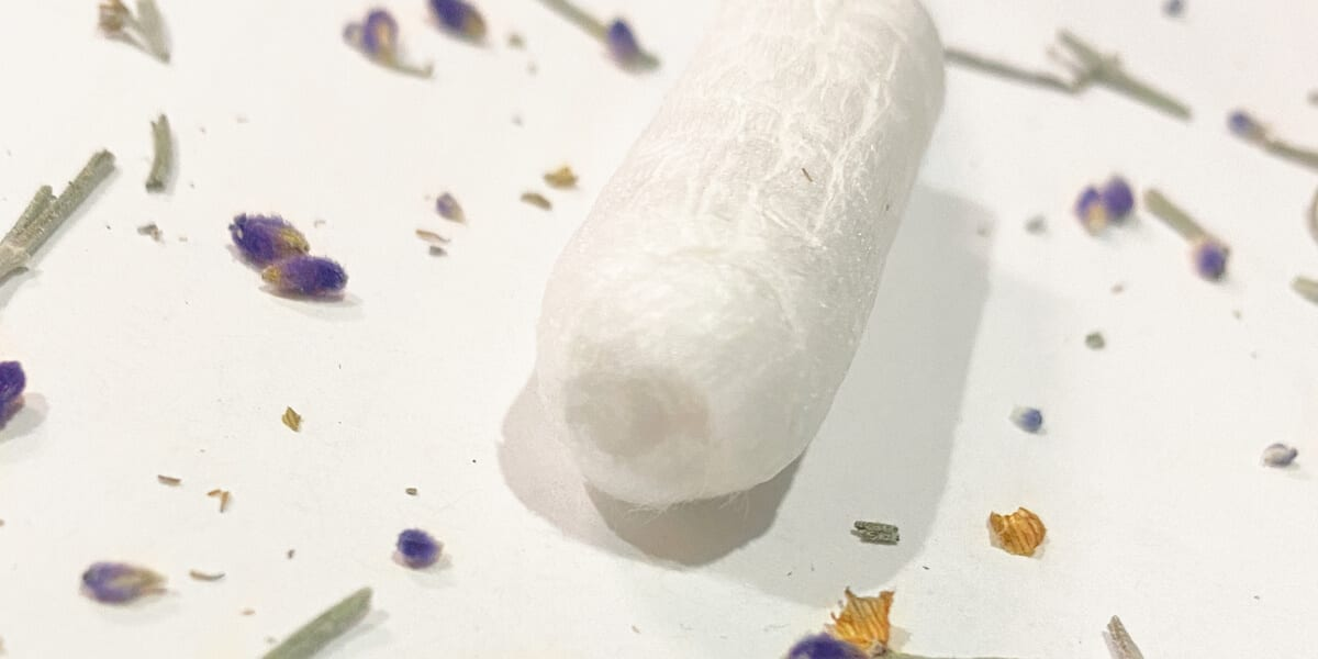 scented tampon on table with pieces of lavender