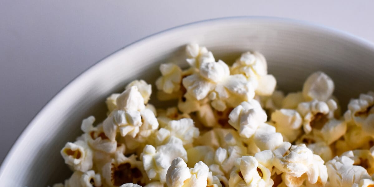 popped popcorn in a white bowl