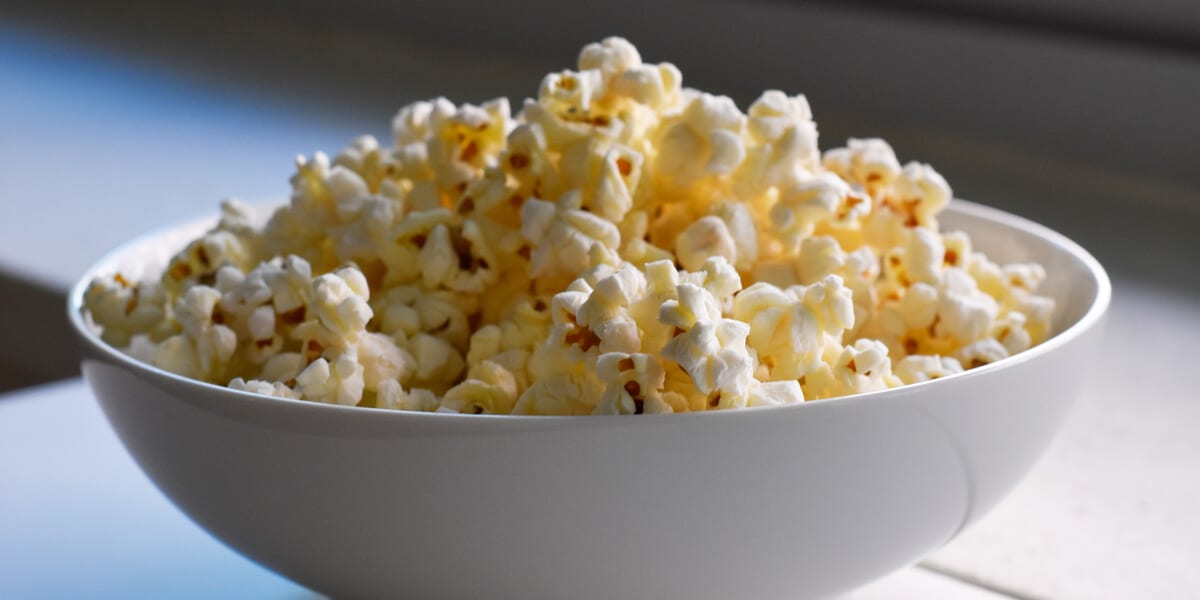 white bowl filled with popcorn