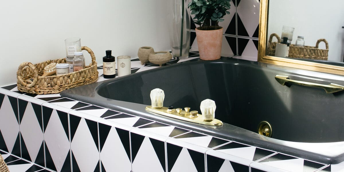tiled bathtub, plants basket with Public Goods products