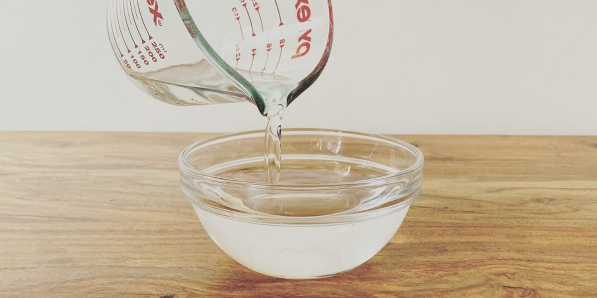 adding 2 cup of isopropyl alcohol to bowl