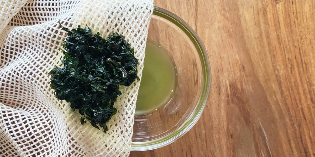 straining peppermint leaves into bowl