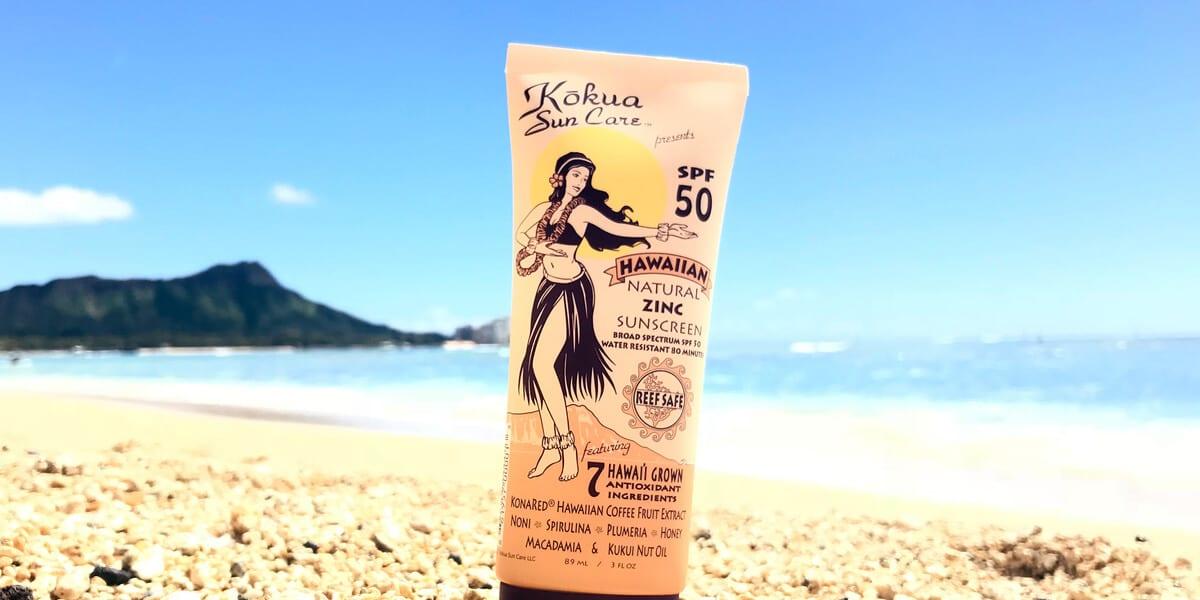 kokua sun care bottle on beach sand