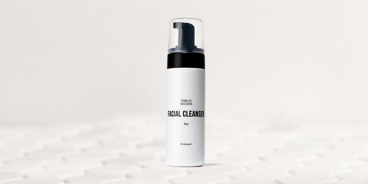 bottle of public goods facial cleanser on tile countertop