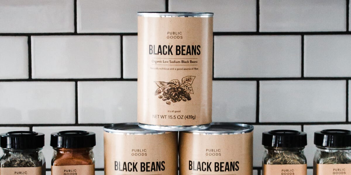 three cans of public goods organic black beans, four jars of public goods spices