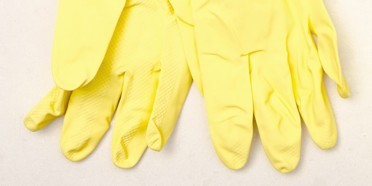 a pair of yellow latex gloves