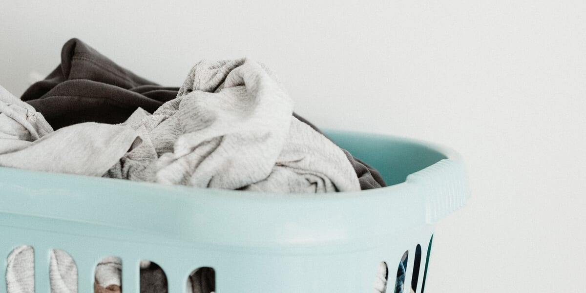 laundry in a light blue laundry basket