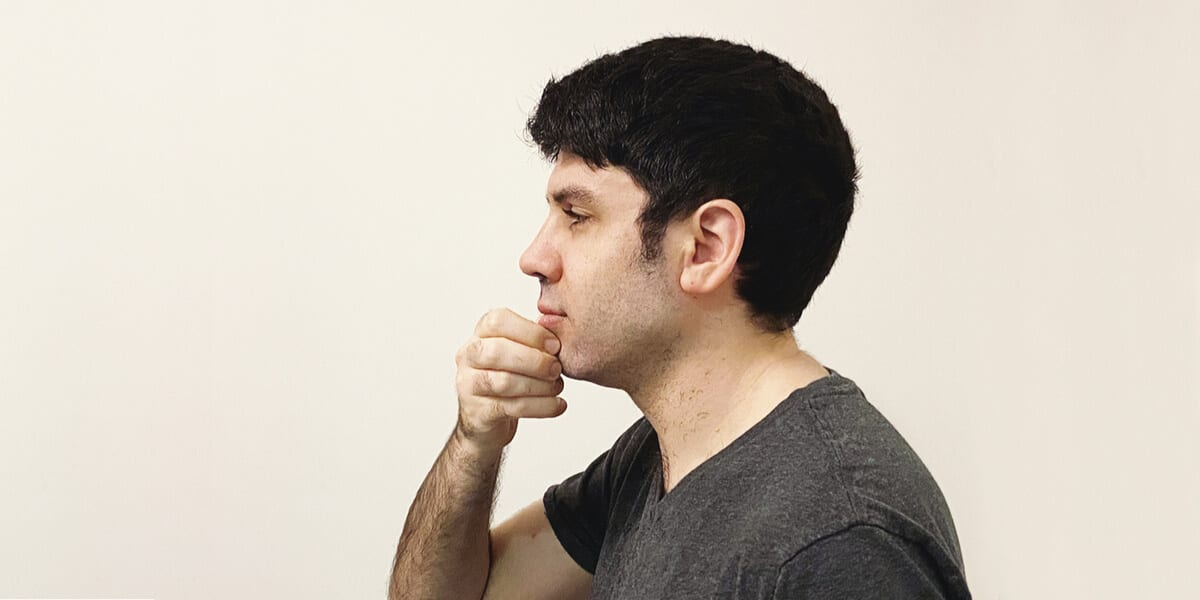 man touching freshly shaved face