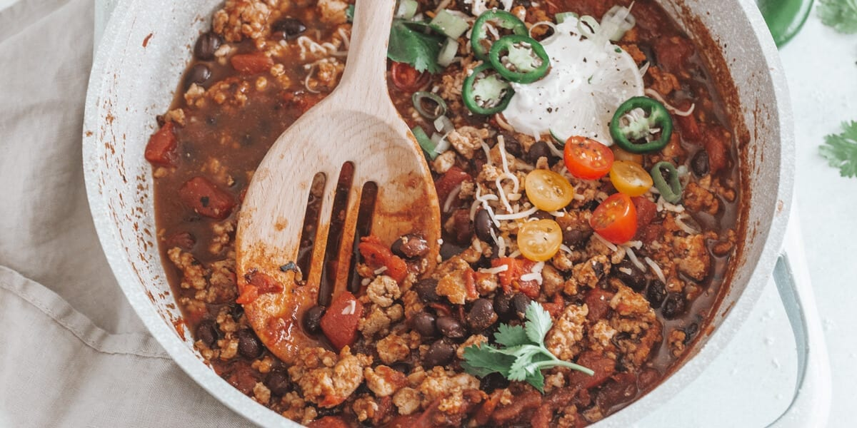 bowl of chili with beans, tomatoes, jalapenos, beef