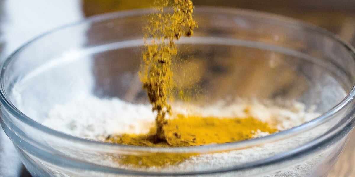 pouring tumeric in the bowl