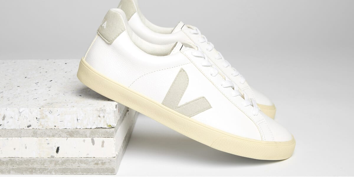 a pair of white veja sneakers