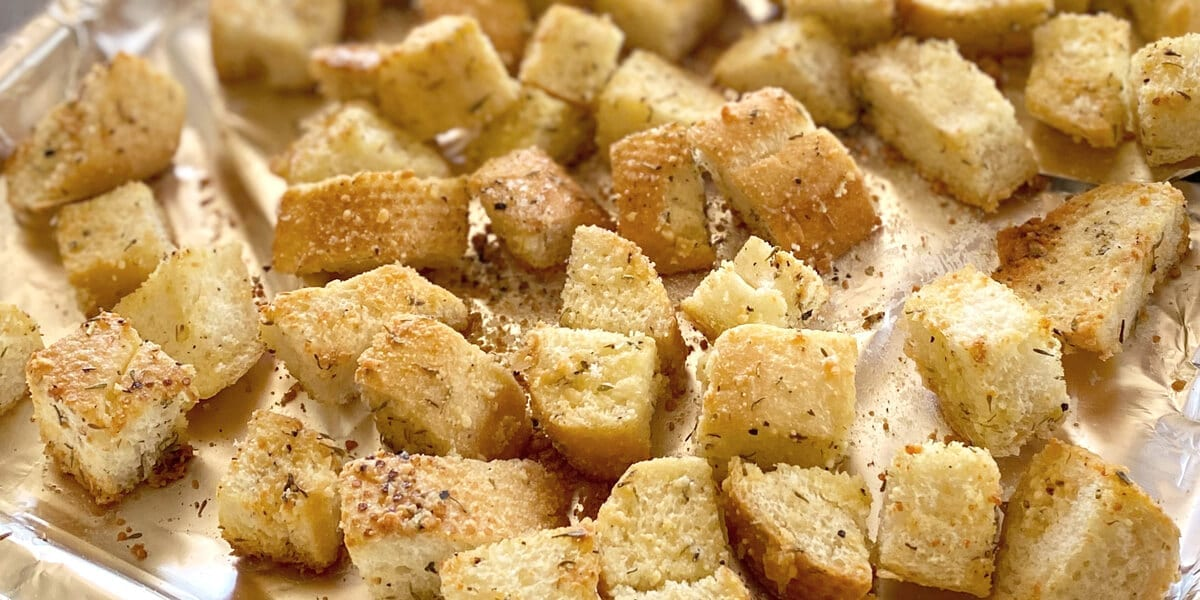 herbed croutons on a baking sheet
