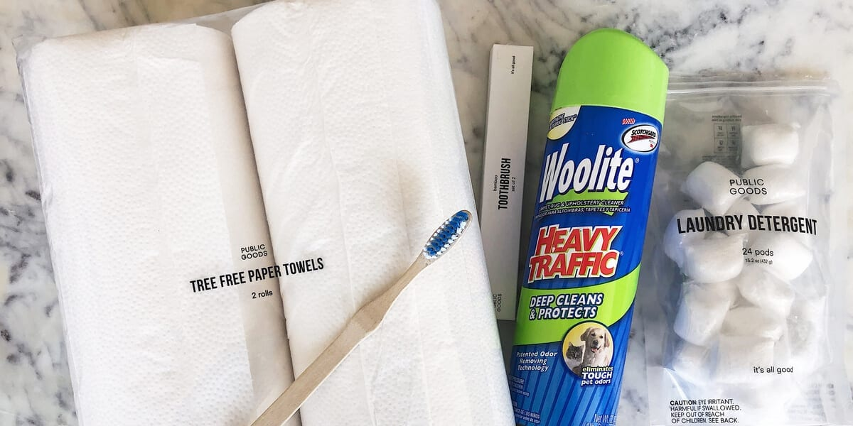 bamboo toothbrush, two rolls of paper towels, laundry detergent pods, can of Woolite carpet cleaner