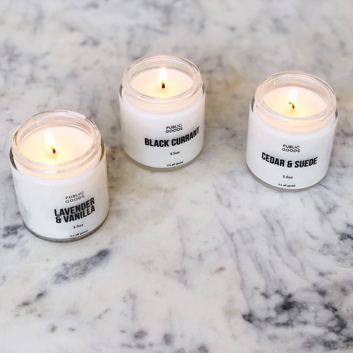three lit candles from public goods