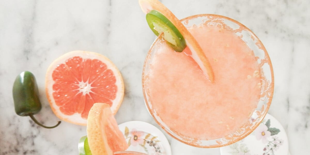two drinks with grapefruit and jalapeno