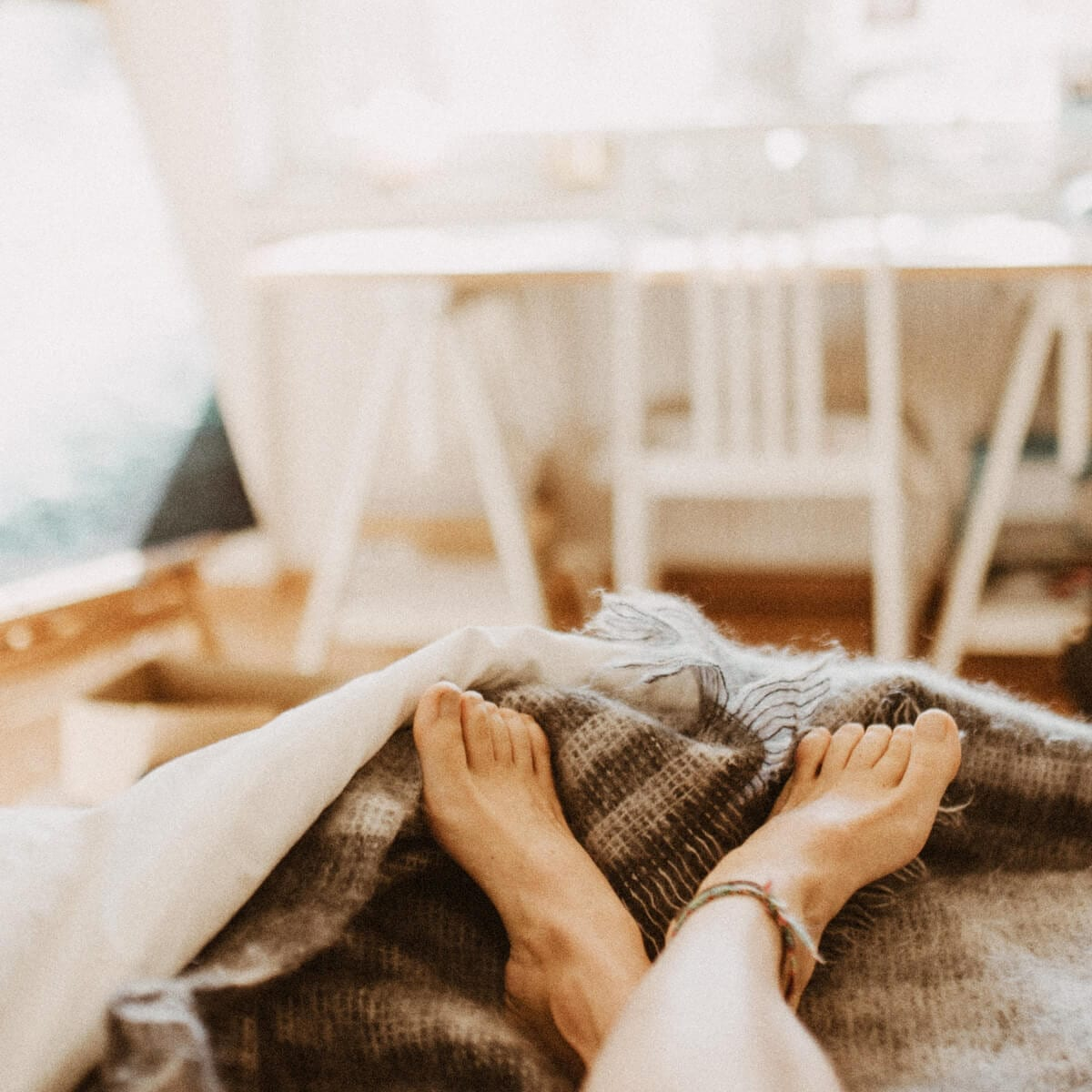 woman feet in bed