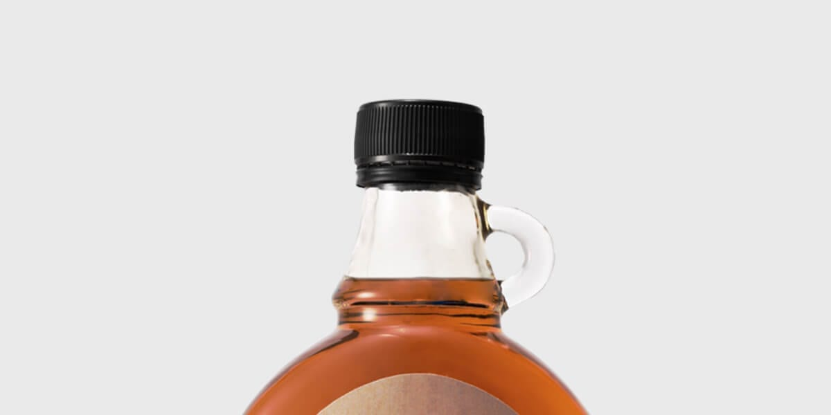 top of maple syrup bottle with black twist top