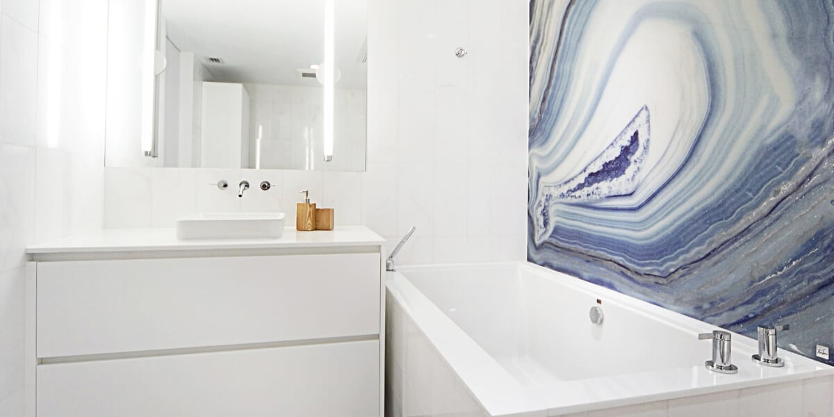 White bathroom with a painting of granite design