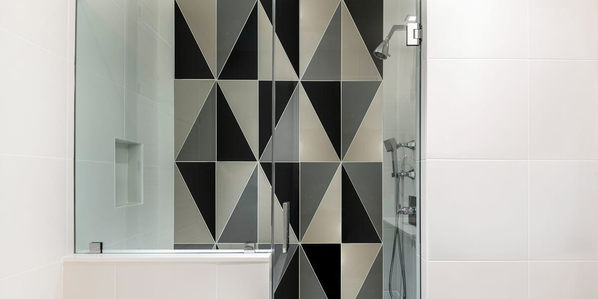 shower with a grey and black wall