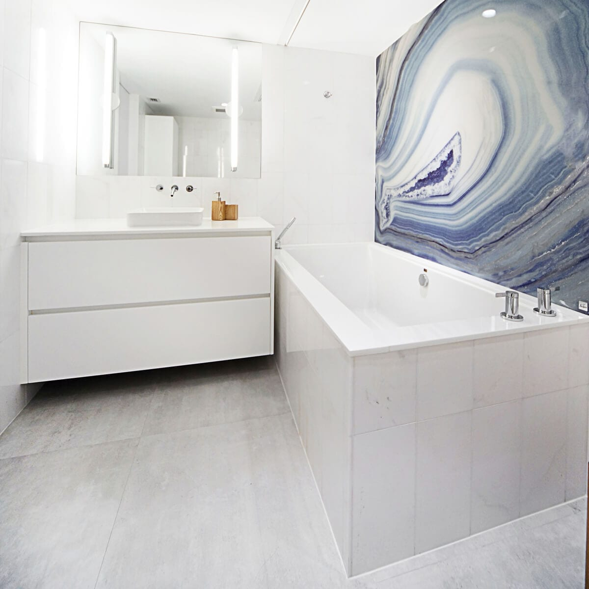 white bathroom with a painting with a granite design
