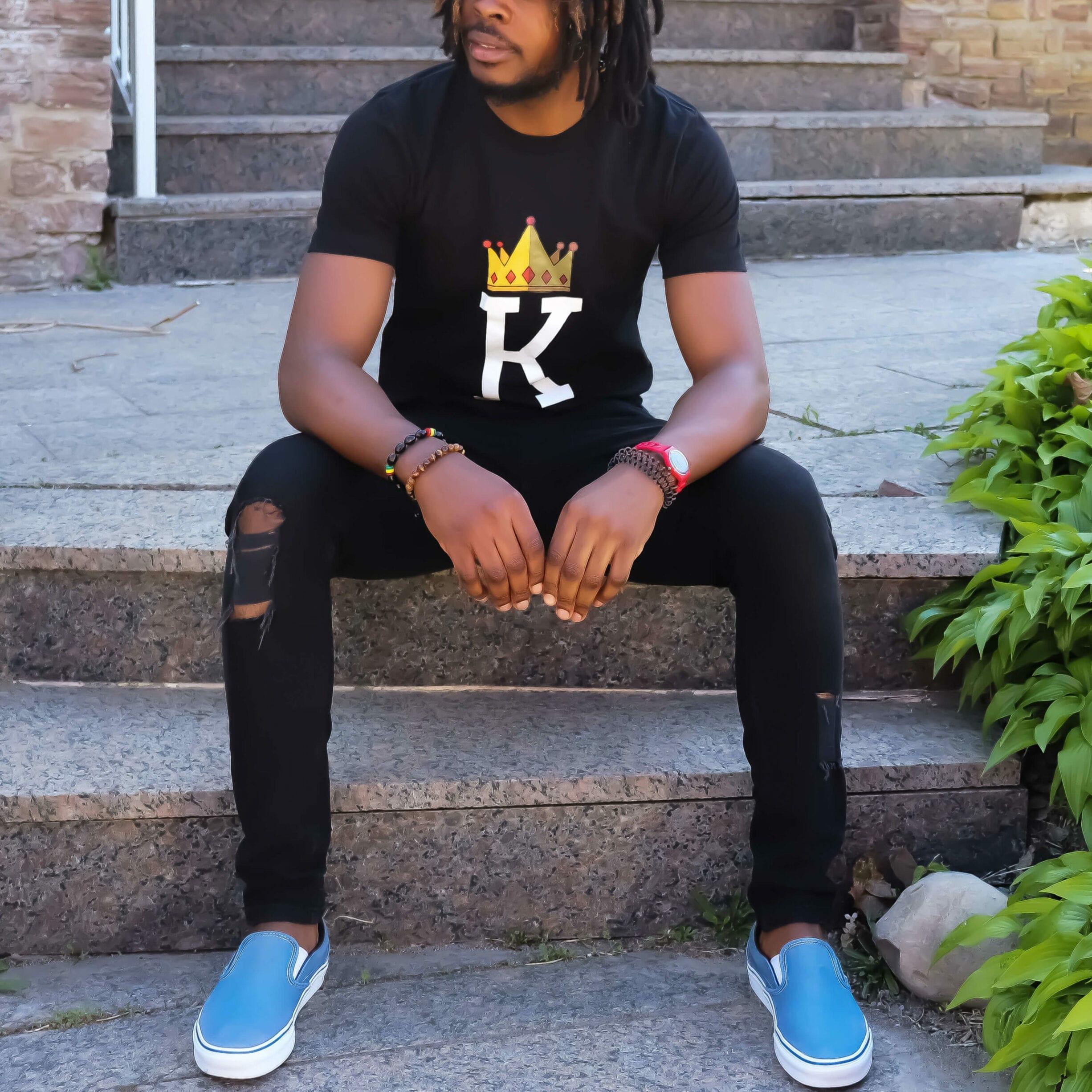 black man sitting on steps