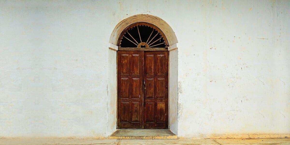 wooden double doors in front of house