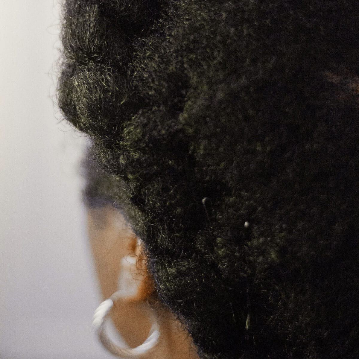 black woman with black hair and an earring