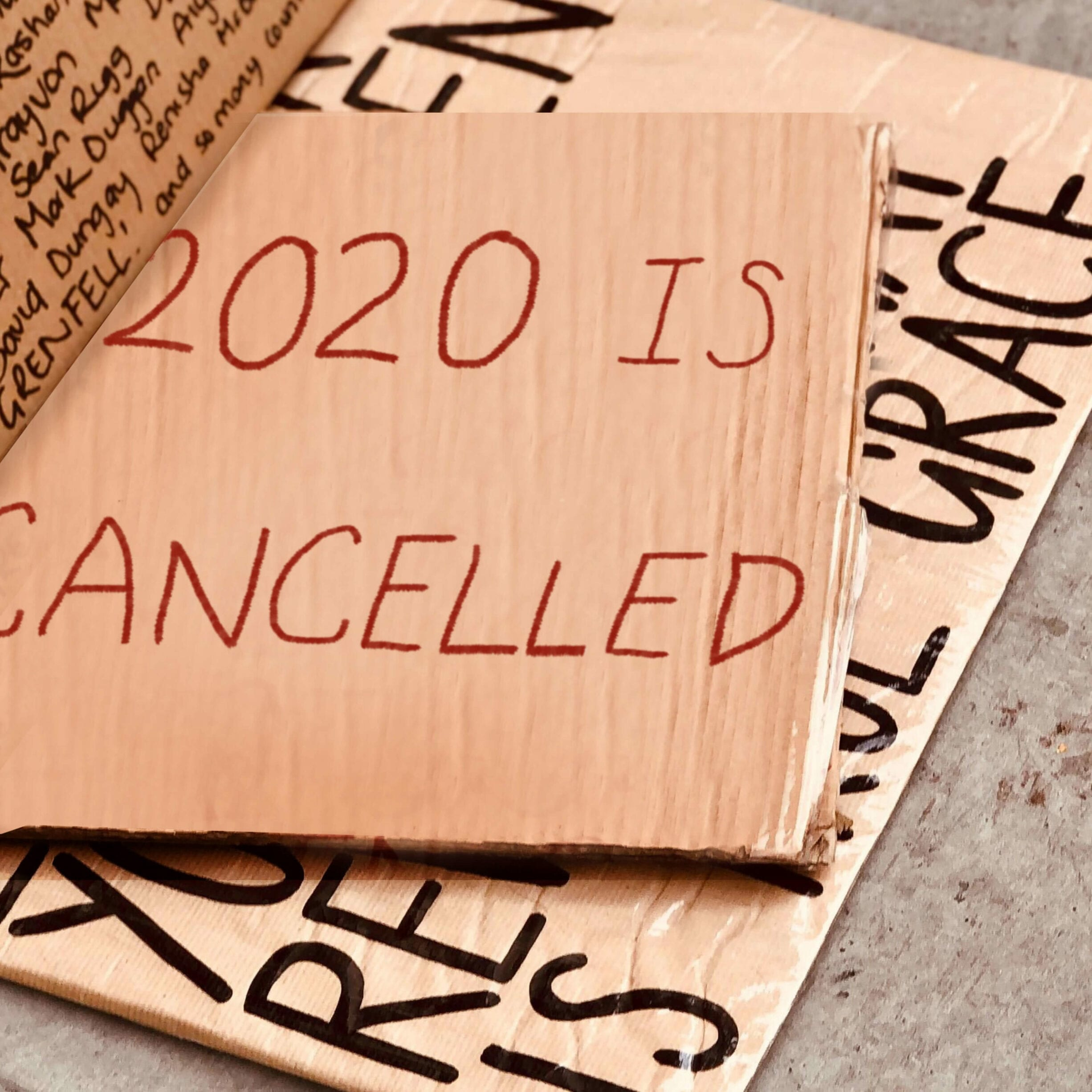cardboard protest sign that reads 2020 is cancelled
