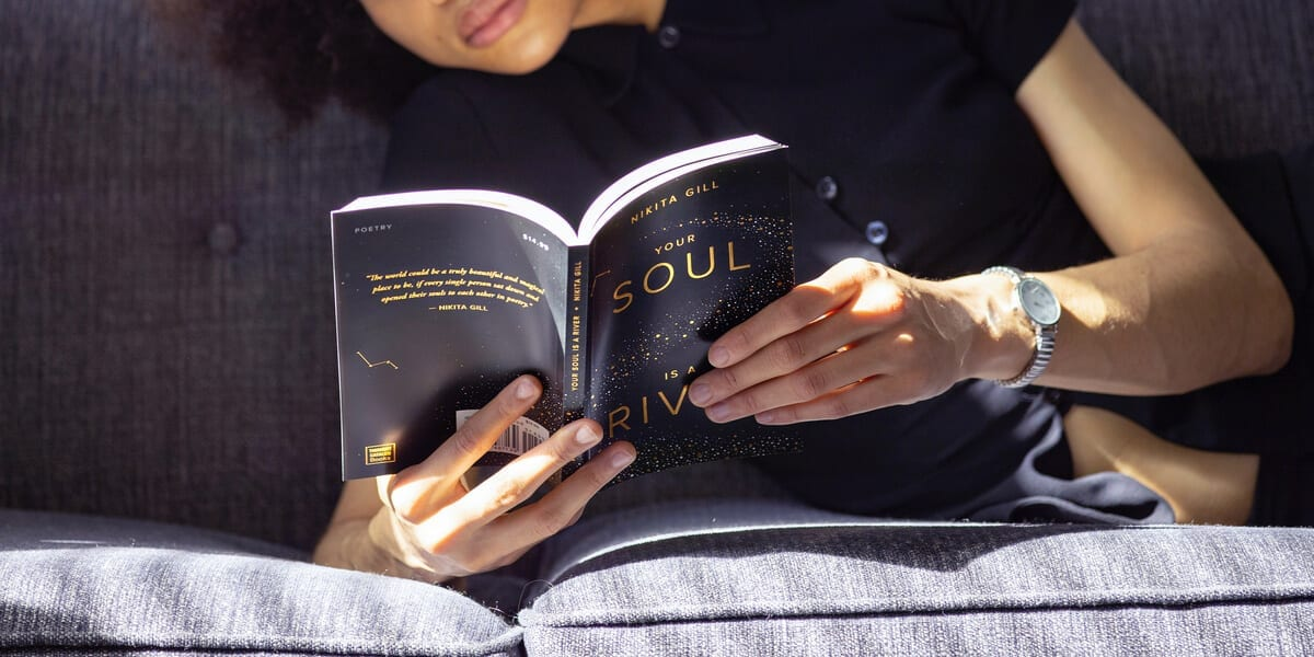 black woman reading your soul is a river by nikita gill