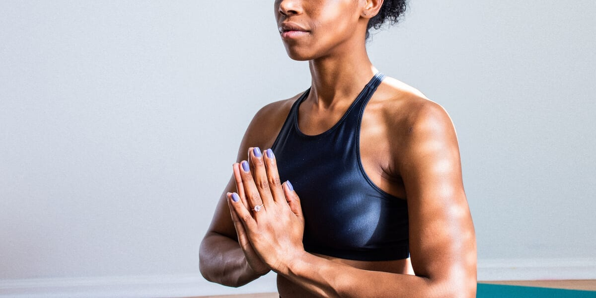 woman in a blue top meditating