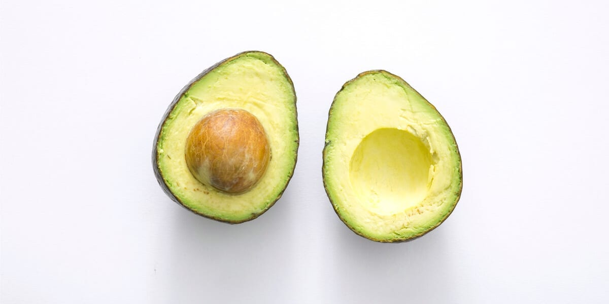 avocado cut in half with seed visible