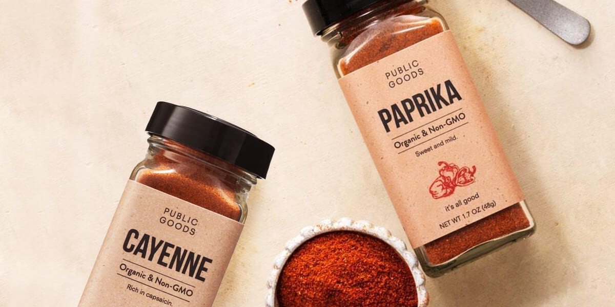 sealed container of cayenne pepper, sealed container of paprika, spice in a metal cup