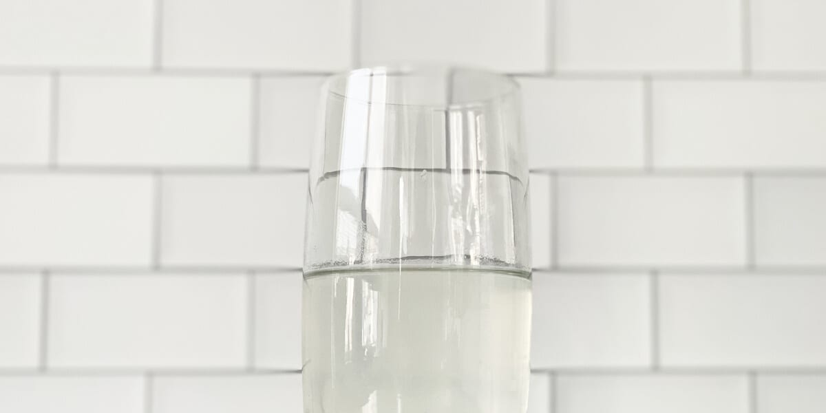 aloe vera gel and water blended in a glass