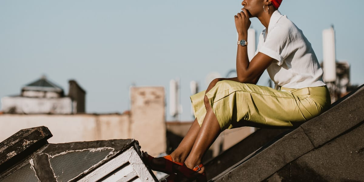 black woman sitting on a rooftop