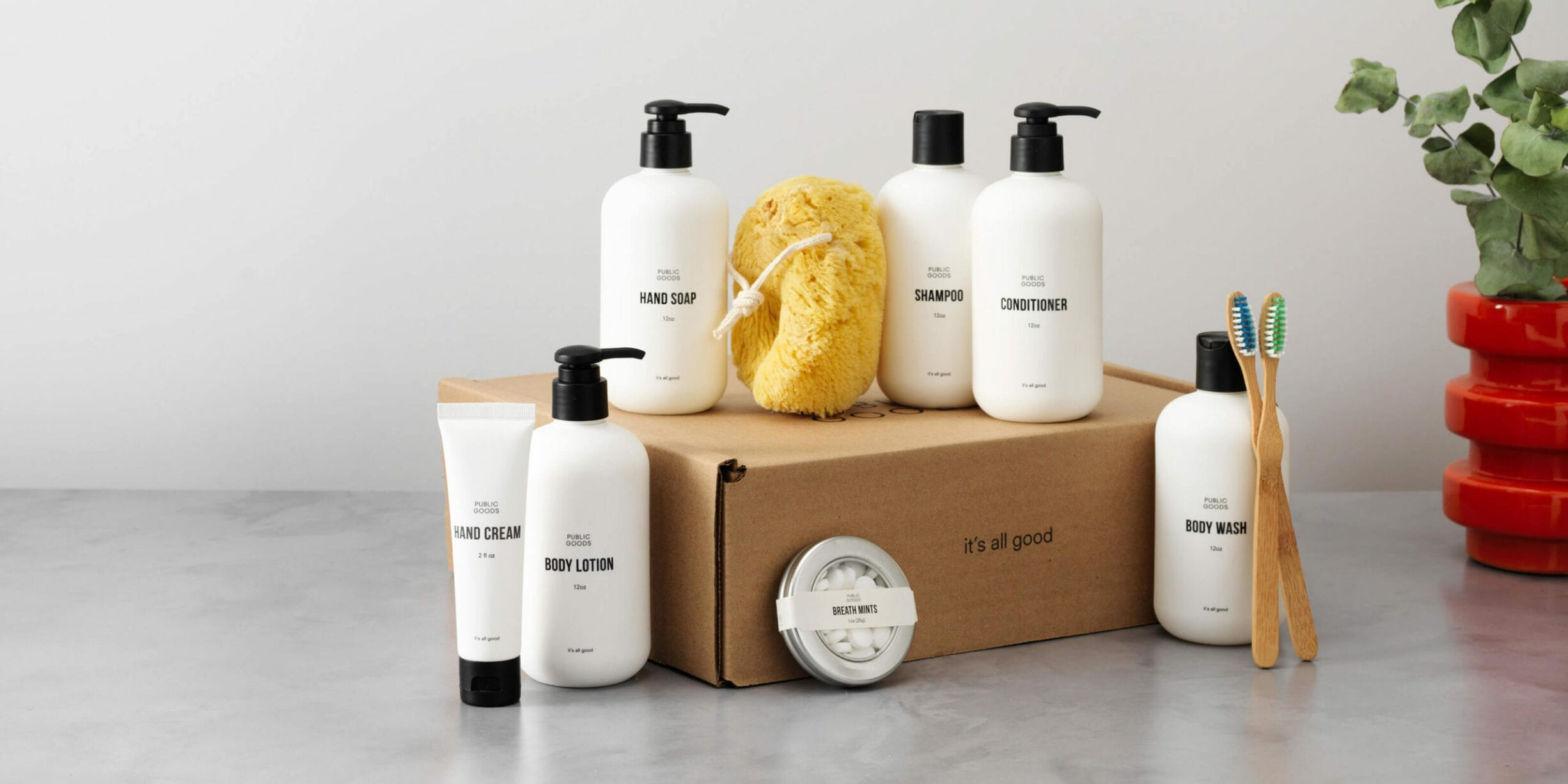 public goods bundle with hand cream, body lotion, mints, hand soap, sponge, body wash, shampoo, conditioner, toothbrushes