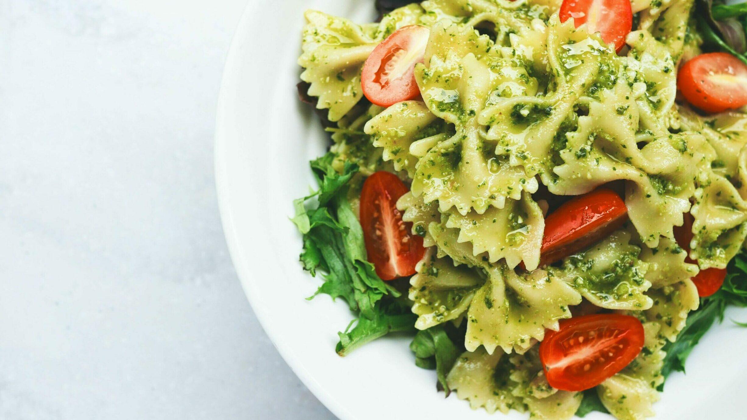 bowtie pasta with pesto tomatoes and arugula