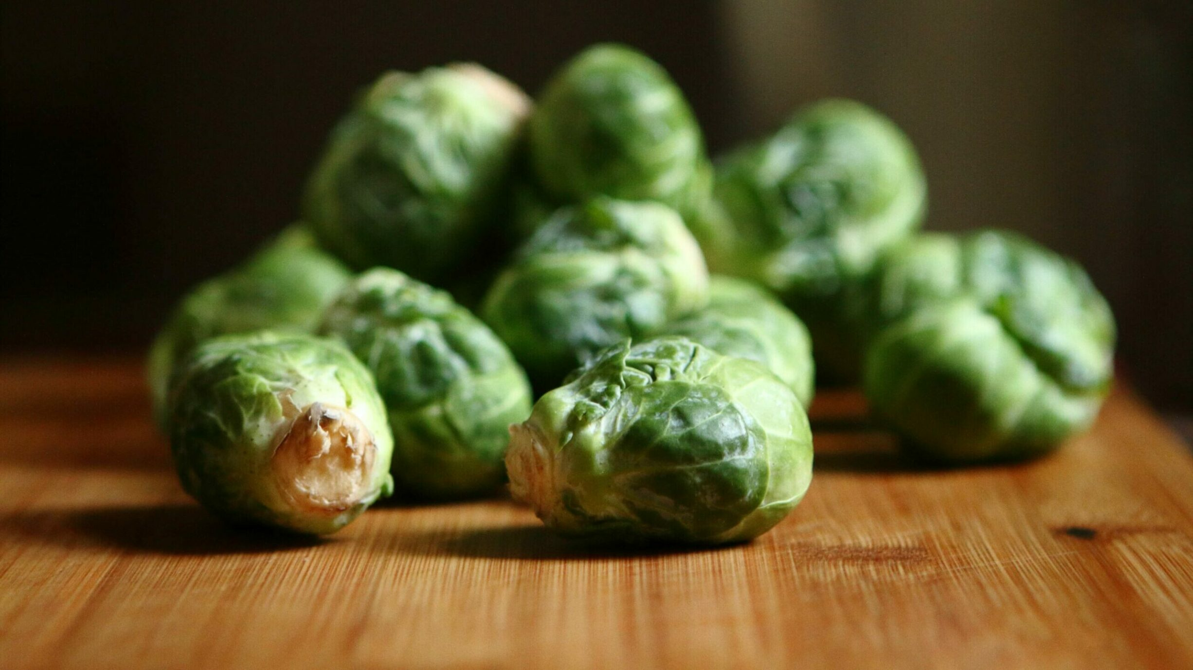 raw brussel sprouts on table