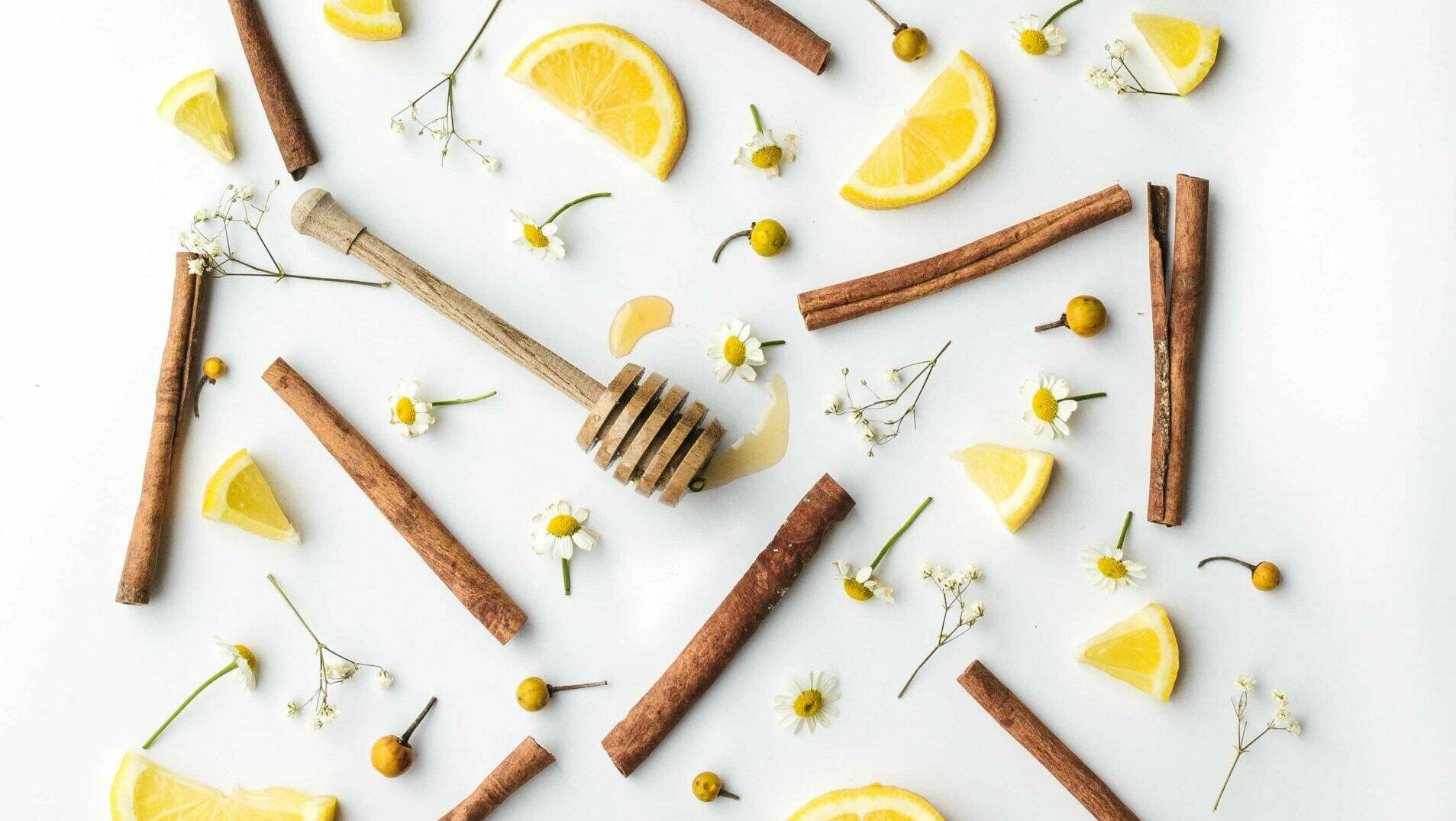 lemon slices, cinnamon sticks, honey comb, flowers, herbs