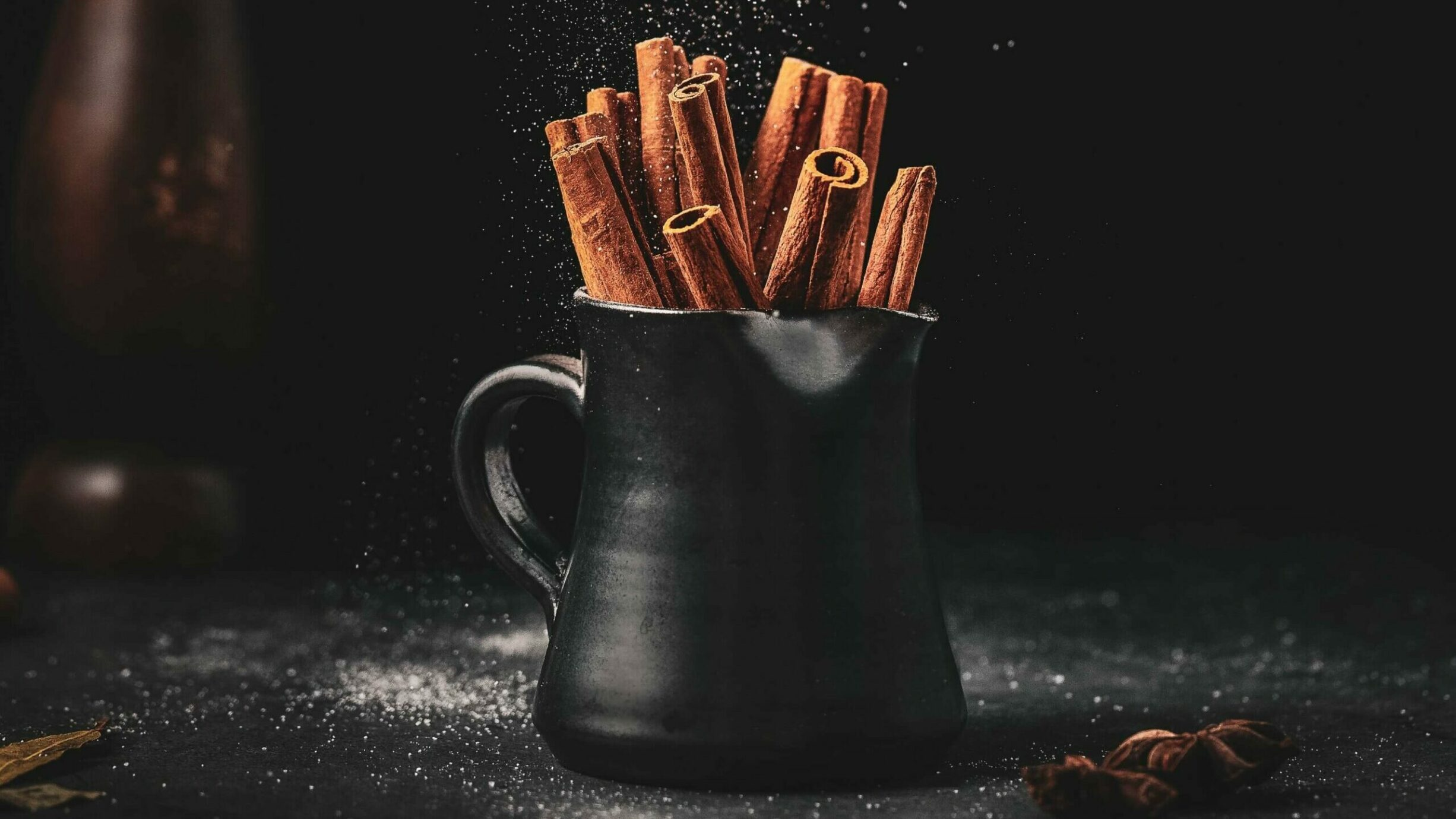 cinnamon bark in a black coffee mug