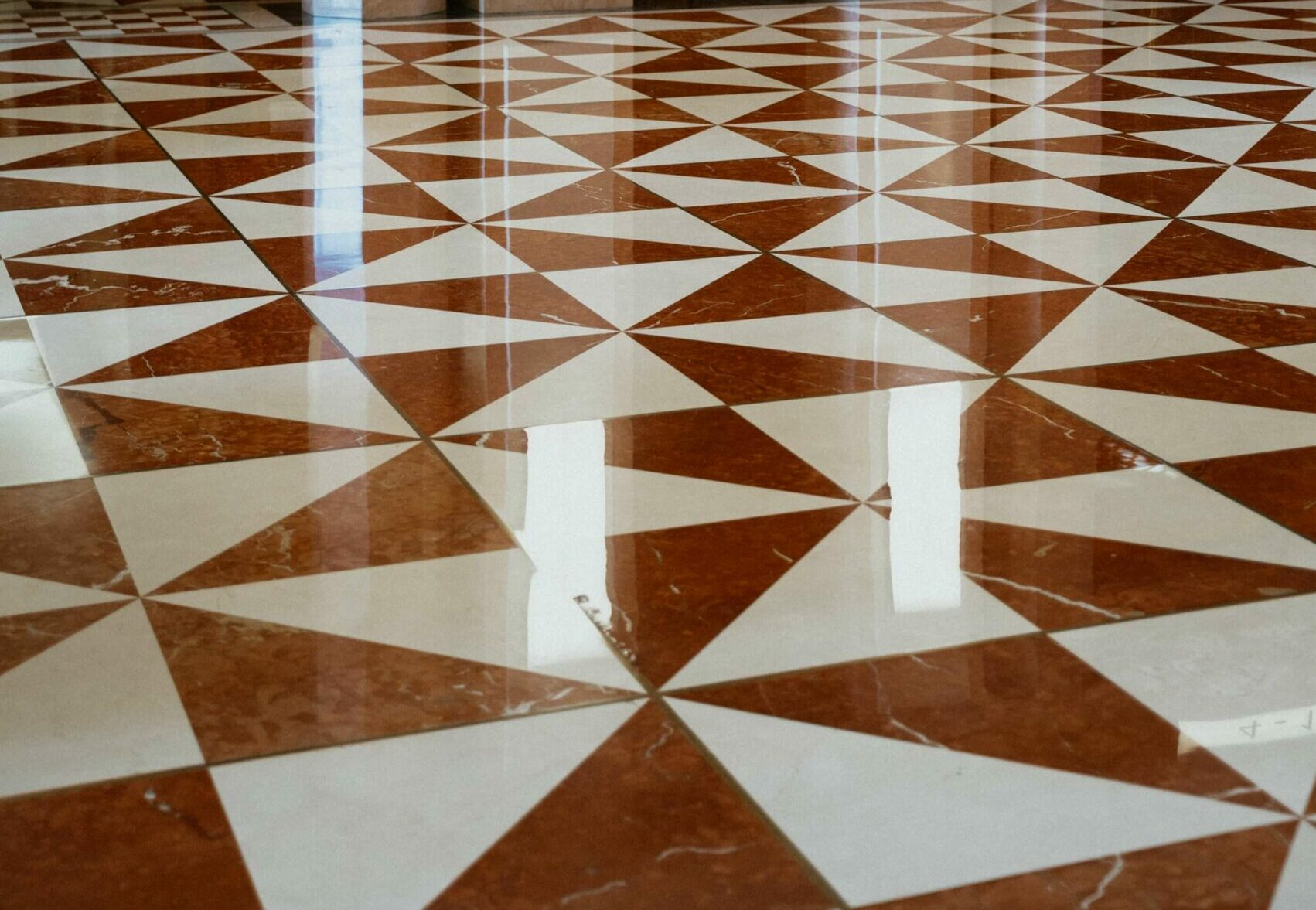 brown and white patterned tile floor