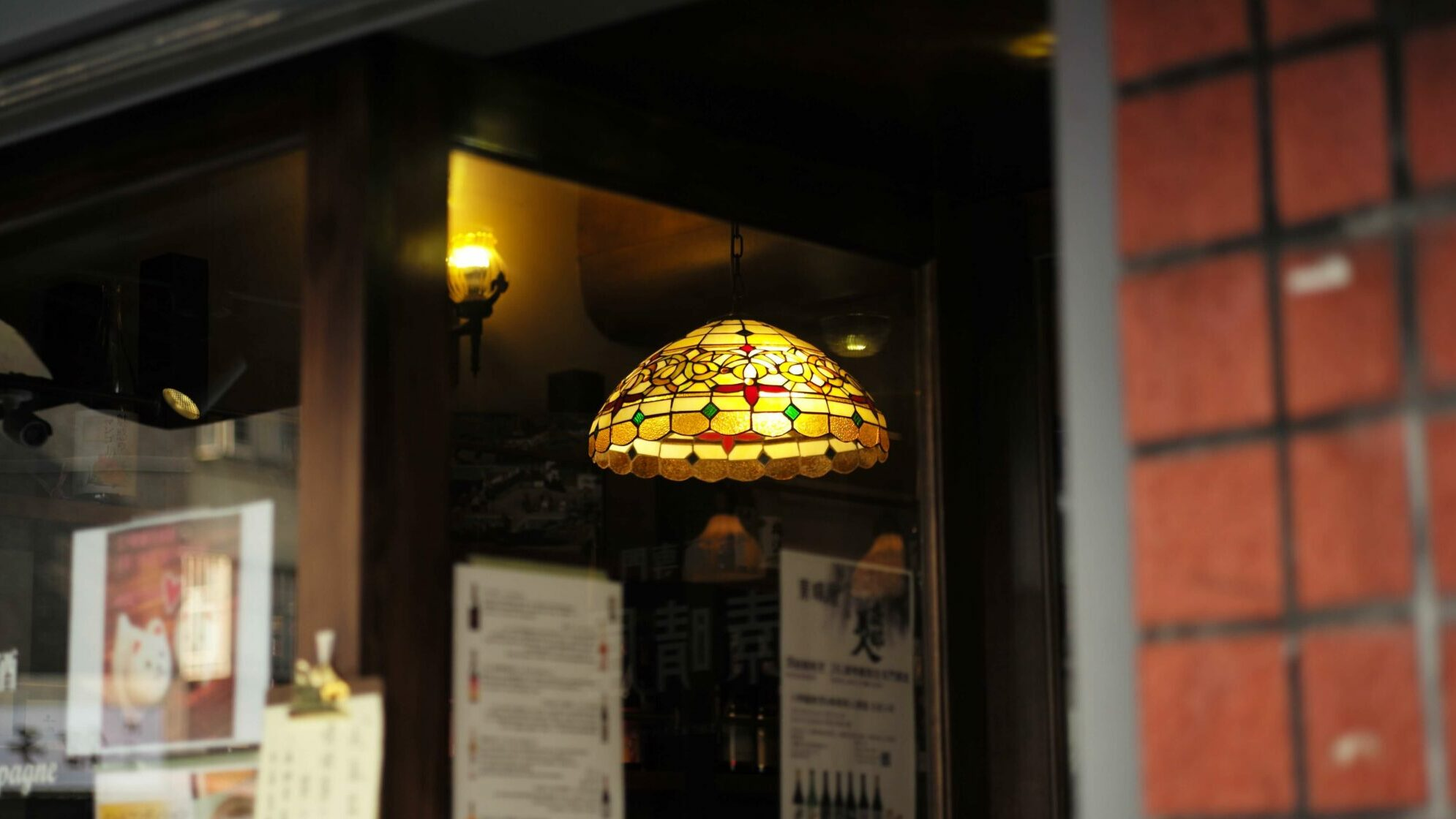 yellow glass lighting fixture hanging in shop