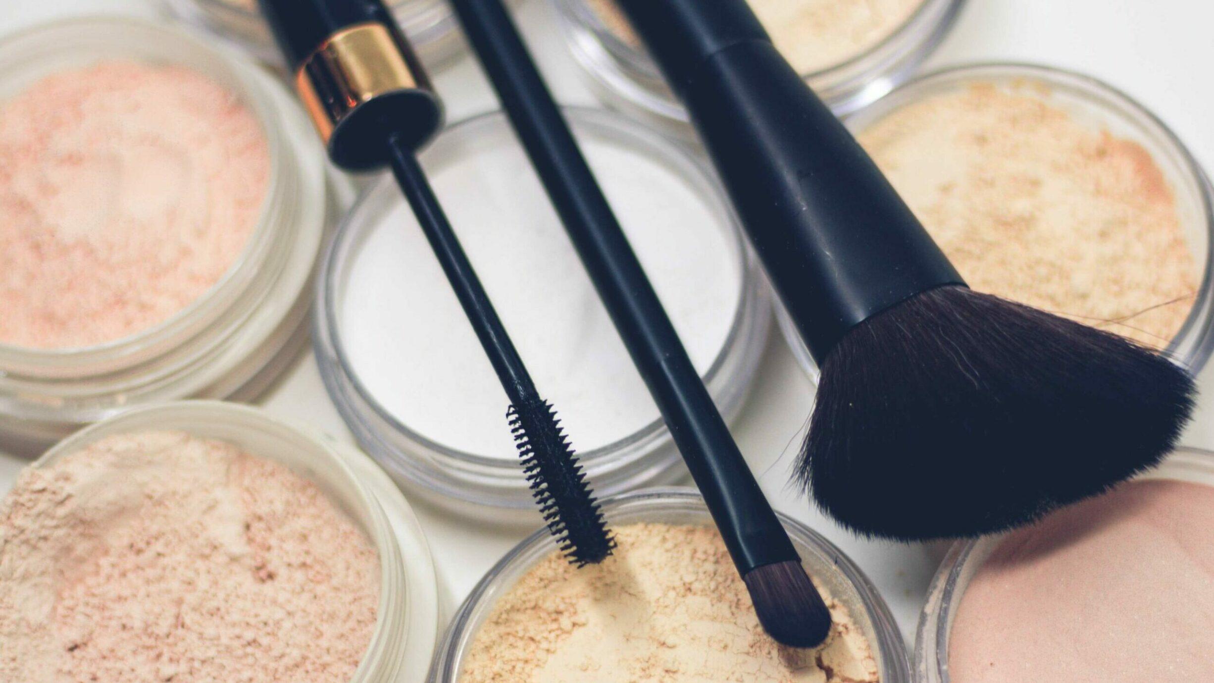 three make up brushes, cosmetics