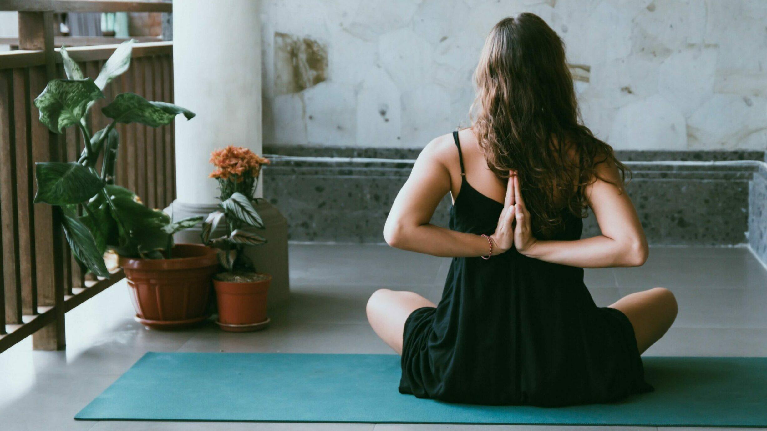 women meditating outside of a yoga mat