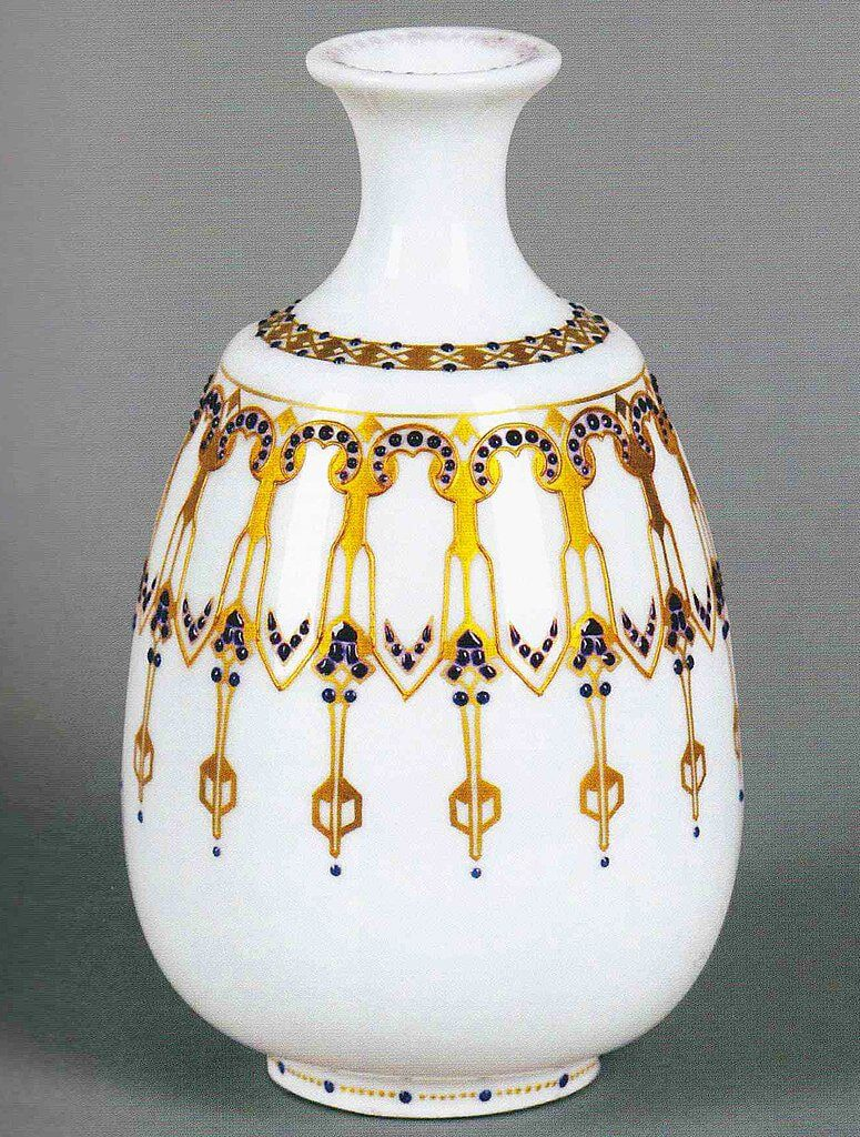 white and gold art deco vase